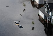 Cars and first floors of homes are submerged Monday in Fayetteville, N.C., in the aftermath of Hurricane Florence.