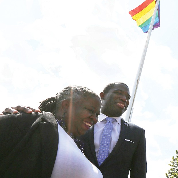 Mayor Levar M. Stoney joins Lacette Cross, co-founder of Black Pride RVA, in celebrating Virginia Pride Week as the rainbow flag flies above them on Brown's Island. Wednesday's ceremony raising the banner of the LGBTQ community took place ahead of the popular VA PrideFest scheduled for 11 a.m. to 9 p.m. Saturday, Sept. 22, on the Downtown riverfront island.