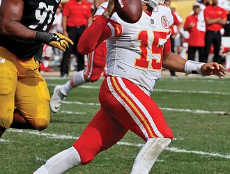 Kansas City Chiefs quarterback Patrick Mahomes scrambles away from Pittsburgh Steelers defensive end Stephon Tuitt during the second half of last Sunday's game in Pittsburgh. The Chiefs won the game 42-37.