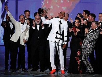 """RuPaul Charles, originator of """"RuPaul's Drag Race,"""" is cheered by a bevy of supporters while accepting the Emmy for outstanding reality-competition program."""