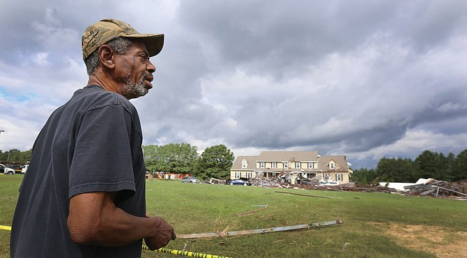 Earnest Claxton of Richmond surveys the damage in his former Chesterfield County neighborhood on Tuesday after learning about the destruction in the area caused Monday by tornadoes spawned by remnants of Hurricane Florence.