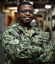 Petty Officer 3rd Class Jarrell Gladdenserves as a Navy cryptologic technician (technical) class aboard the Iwo Jima, an amphibious assault ship.