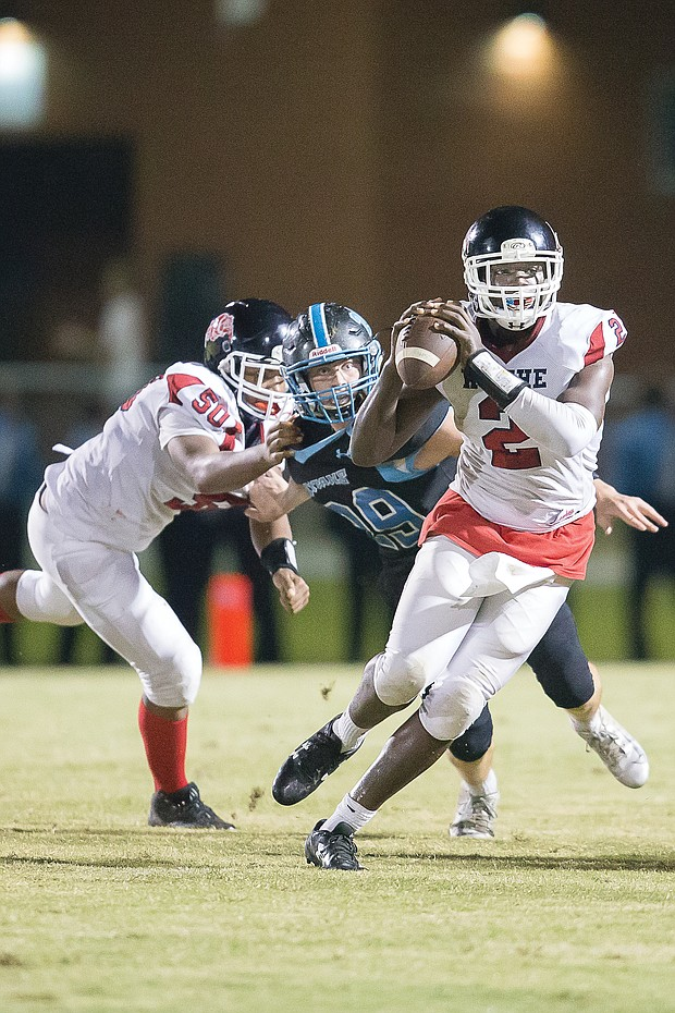 George Wythe High School quarterback Emontre Bass gets the blocking he needs to get a pass off during the Richmond school's Sept. 21 game against Chesterfield County's Cosby High School.
