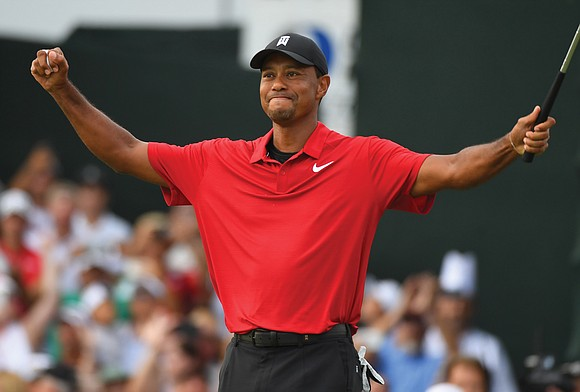 Tiger Woods was moved to the brink of tears after capturing his first title since 2013 with a two-stroke triumph ...