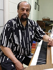 Larry Bland is in practice mode as he prepares for the first of his final concerts as director of The Volunteer Choir, which is marking its 50th year. Location: The choir's rehearsal room at Second Baptist Church on Idlewood Avenue, where the choir was started in 1968.