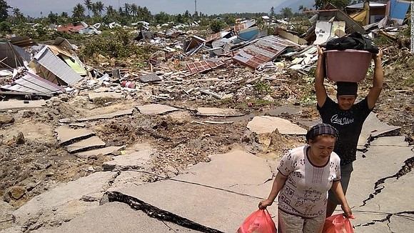 Rivers of soil swept away entire neighborhoods in Indonesia following a powerful earthquake last week that also generated a tsunami ...