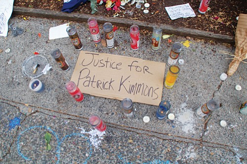 Flowers, candles and messages honor the memory of Patrick Kimmons who died in an officer-involved shooting Sunday in downtown Portland.