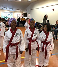 Portland martial arts students Olivia Edwards-El (left), Gracie Edwards-El, and Angelie Fitz-Cortez participate in competition.