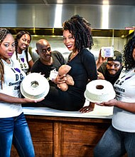 Baked in Baltimore co-founders, April Richardson and Derek Lowery (center in black) surrounded by their DC Sweet Potato Cake team.
