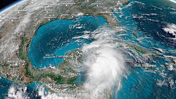 "Michael, now a Category 1 hurricane slashing Cuba, is forecast to be a ""dangerous major hurricane"" when it smacks the ..."