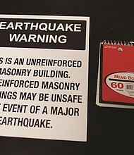A new placard warning for unreinforced masonry buildings.