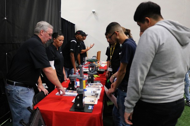 Local students approach vendors to learn more about what they have to offer during Joliet Junior College's fifth annual Manufacturing Day, held Oct. 9 at the college's main campus in Joliet.