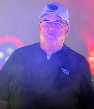 Titans defensive coordinator Dean Pees walks out of the locker room before a  game at Nissan Stadium in Nashville, Tennessee in 2018.