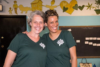 "L-r: Kyla Liggett-Creel, LCSW-C, PhD, and Henriette Taylor, MSW, LGSW, celebrate a successful graduation ceremony for ""Parent University,"" a Promise Heights program"