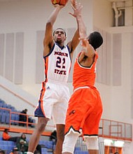 Phil Carr makes a jump shot over a Florida A&M defender. The former Morgan State University forward signed a contract with the New York Knicks on October 2, 2018.