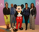 "Disney Dreamers Academy held its ""100 Minutes to Empower Your Dreams"" seminar Thursday, Sept. 27, at the Schomburg Center in Harlem, New York. Following the event, Mickey Mouse posed with guest speakers that included, from left: Julee Wilson, senior fashion director for ESSENCE magazine; Jonathan Sprinkles, motivational speaker; Brandi Harvey, motivational speaker; Tracey Powell, Disney Executive Champion"