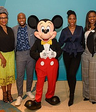 """Disney Dreamers Academy held its """"100 Minutes to Empower Your Dreams"""" seminar Thursday, Sept. 27, at the Schomburg Center in Harlem, New York. Following the event, Mickey Mouse posed with guest speakers that included, from left: Julee Wilson, senior fashion director for ESSENCE magazine; Jonathan Sprinkles, motivational speaker; Brandi Harvey, motivational speaker; Tracey Powell, Disney Executive Champion"""