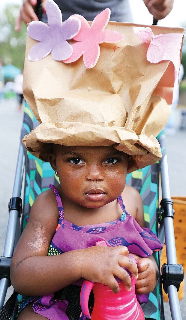 She's got the look: Daziyah Hewlett shows off the fancy crown she and her mom, Johanna Whitaker, created last Saturday at the 30th Annual 2nd Street Festival in Jackson Ward. The free two-day event, highlighted by music, food, history and culture, also included a Kidz Zone with special activities run by the Children's Museum of Richmond. (Regina H. Boone/Richmond Free Press)
