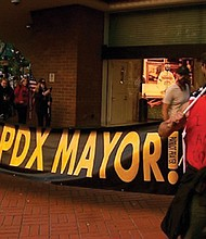 Right-wing protestors raise a banner in downtown Portland Saturday in criticism of Mayor Ted Wheeler for his response to police using a hands-off approach during a protest of an officer-involved shooting that blocked a street and grew violent one week earlier.  (KOIN photo)