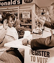 A member of the community gets help registering to vote outside the former McDonalds restaurant at Northeast Martin Luther King Jr. and Fremont in this historical photo from the Oregon Historical Society.