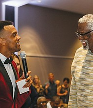 David Lucus of the Maurice Lucas Foundation (left) chats with former NBA great Bill Russell at the eighth annual Maurice Lucas Foundation gala.