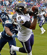 Ravens wide receiver Michael Crabtree makes a diving touchdown catch against the Tennessee Titans at Nissan Stadium.