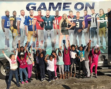 Comcast and NBC Sports collaborated to bring the Sunday Night Football (SNF) Tour bus to the Boys & Girls Clubs ...
