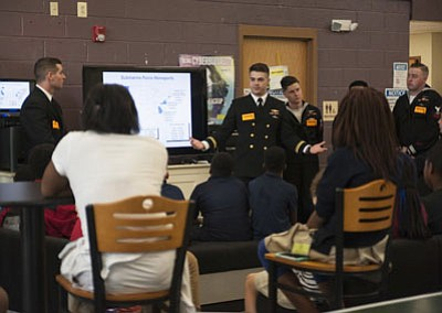 Crew members assigned to the Ohio-class ballistic missile submarine USS Maryland (SSBN 738) visited Fort Meade Teen Center at Fort ...