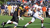 Virginia State University quarterback Cordelral Cook tries to hang onto the ball while under pressure from the Bowie State University defense at last Saturday's game in Maryland. The VSU Trojans fell to the Bulldogs 20-15.