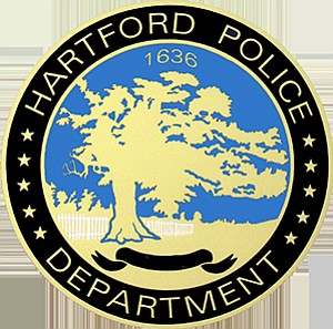 A white police officer in Hartford, Connecticut, was relieved of duty and...