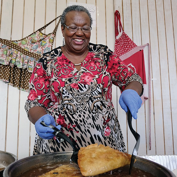Frances Davis of Rocky Mount demonstrates the art of making fried apple pies during the Richmond Folk Festival. (Sandra Sellars/Richmond Free Press)