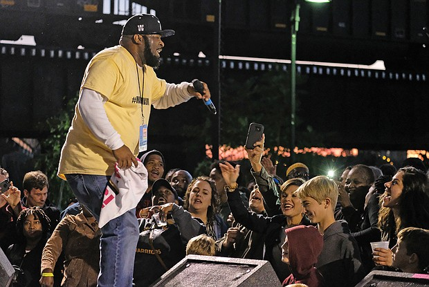 The roots, richness and variety of music and cultures were on display at the Richmond Folk Festival. New Orleans bounce artist Ricky B. moves the crowd. (Sandra Sellars/Richmond Free Press)