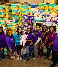 High school student Lauren Eisele, UMMC, and the University of Maryland School of Social Work all partnered to organize a diaper drive. Lauren led the effort to collect over 105,000 diapers, and 25,000 wipes for the drive. She is pictured with Sierra Mason and Mason's children Saniya, Za'Mari and Za'Vion Nipper and staff from B'more for Healthy Babies. The diapers and wipes were distributed to community partners on Friday, October 19, 2018 at the University of Maryland Baltimore County, Central Receiving Building located at 1000 Hilltop Circle in Baltimore, Maryland.