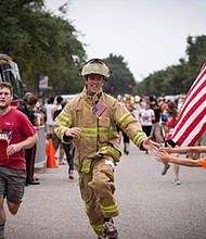 The Travis Manion Foundation 9/11 Heroes Run 5K race and 1 mile Fun Run unites the community to remember the nearly 3,000 lives lost on 9/11, as well as to honor our veterans, military, and first responders who serve our country and our communities. (Above) A firefighter high-fives children in the crowd cheering on the runners in a previous race. For more information about the 9/11 Heroes Run in Annapolis or to register, visit: www.911heroesrun.org/annapolis.