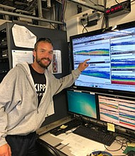 KIPP Teacher Justin Garritt learns how to read acoustic transducer technology to monitor fish populations in the Pacific Northwest.