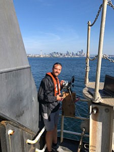 Justin Garritt calibrating the research equipment in the Port of Seattle aboard NOAA Bell A.  Shimada.