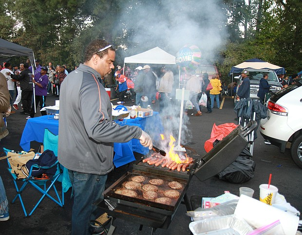 Hundreds reunited at Virginia State University last weekend to celebrate homecoming 2018. Students, staff, faculty and others turned out for a weeklong variety of homecoming programs, including a gospel extravaganza, comedy showdown, jazz and hip-hop concerts, the Presidential Scholarship golf tournament and coronation program for the homecoming court, that started Oct. 13 and culminated with the homecoming tailgate and football game last Saturday at Rogers Stadium on the Ettrick campus. Kevin Barnes of Richmond handles the grill at a tailgate outside the stadium. (James Haskins/Richmond Free Press)