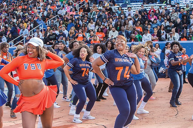 Hundreds of old friends, classmates and their families reunited at Virginia State University last weekend to celebrate homecoming 2018. VSU's renowned cheerleaders pep up the crowd with a few moves. (James Haskins/Richmond Free Press)