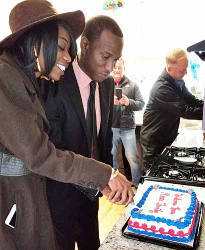 Army Specialist Marcus Moore (pictured with his wife) was recently welcomed into his new mortgage-free home in Steger, IL that was gifted to him by Building Homes For Heroes. Photo Credit: Building Homes for Heroes