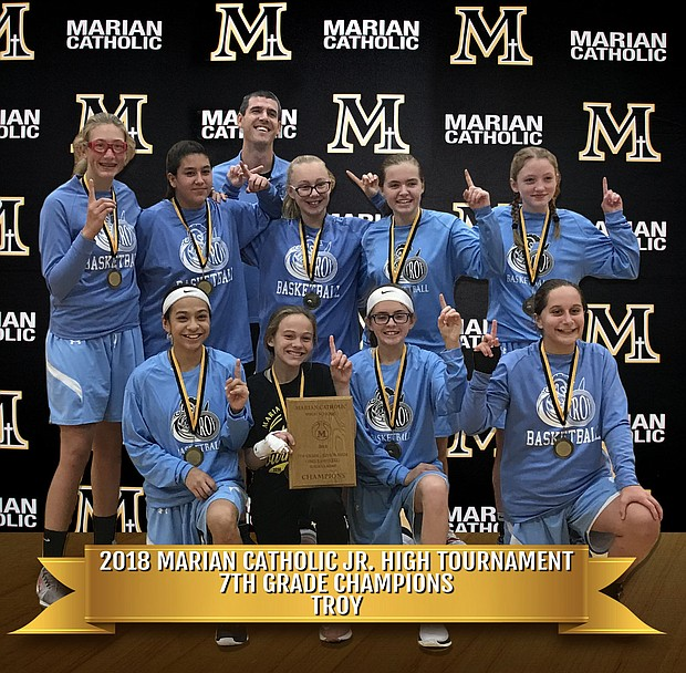 The Troy Middle School 7th grade Girls Basketball Team *were also champions of the 7th Grade Junior High Girls Basketball Tournament at Marian Catholic High School.