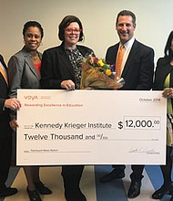"(Left to right) Voya's Doug Peters and advisor Alicia Kong, along with Mark Jackowitz and Sarala Katta, both of Voya Financial, surround Deidre Rabuck (center), Voya's 2018 Unsung Heroes program second-place $12,000 grant award winner. Rabuck is an assistant principal at the Kennedy Krieger School: Fairmount Campus in Baltimore and she plans to use the grant award to help bring ""Fairmount News Station"" to life at her school."