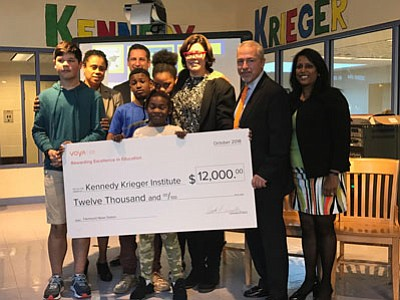 Students from the Kennedy Krieger School: Fairmont Campus stand proudly with assistant principal, Deidre Rabuck, a 2018 Voya Unsung Heroes ...