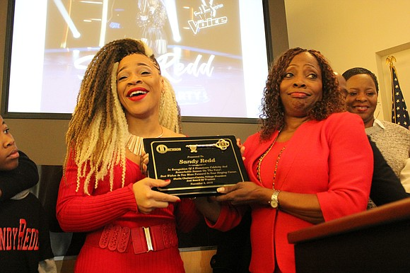 Singing sensation Melinda Bussie, whose stage name is Sandy Redd, was honored by Matteson Mayor Sheila Chalmers-Currin on Saturday for ...