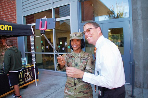 The first female senior enlisted leader in U.S. Army Recruiting Command history, Sgt. Maj. Tabitha Gavia takes a selfie in Vancouver with Union High School Associate Principal Tony Miles during a recent recruiting stop at the school.  Moments earlier, Gavia gave Miles a military coin, considered a special honor.