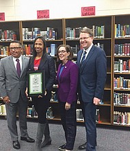 Kari Pilgrim Ricker (second from left) is named Oregon Teacher of the Year during a recent ceremony at Churchill High in Eugene. Also pictured (from left) are Eugene Superintendent Gustavo Balderas, Gov. Kate Brown and Oregon schools chief Colt Gill.
