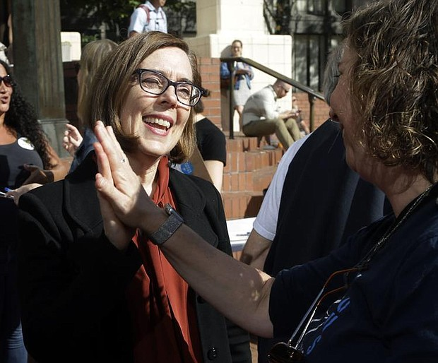 Oregon Democratic Gov. Kate Brown won re-election in Tuesday's November General Election, defeating Republican Knute Buehler, 49 percent to 44 percent. (AP photo)