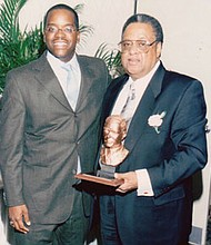 "Mr. Muldrow was the recipient of the Henry G. Parks, Jr Business Award by the Baltimore Marketing Association December 7, 2000. He is shown here with son, Ackneil M. Muldrow, III (""Trey"")"