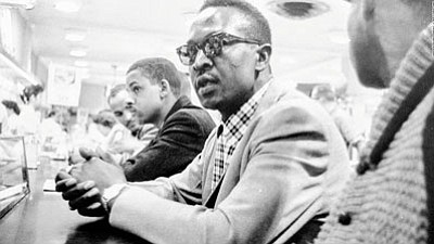 While a student at A&T State University, Muldrow participated in one of the first student lunch counter sit-ins at a Woolworth store in Greensboro, North Carolina to protest segregation.