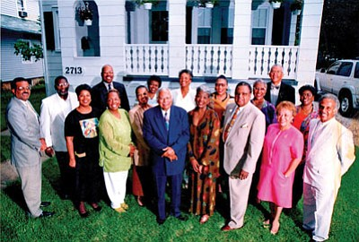 Beloved Ackneil M. Muldrow, II and his wife Ruth, (third and fourth from the right) are surrounded by friends, Reverend Marcus G. Wood, pastor, Providence Baptist Churh (center), good friend Harold D. Young, attorney at law, (left, front row) and others to celebrate their 25th wedding anniversary. Muldrow, who was 80, died of heart failure Oct. 25, 2018 at Sinai Hospital. A Memorial Service will be held on Friday, Nov. 9, 2018 at the March Life Tribute Center located at 5616 Old Court Rd, in Windsor Mill, MD. The Family Hour will begin at 9 a.m., with a Memorial Service to follow at 11 a.m.