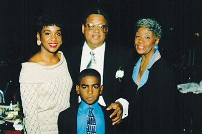 "Left-right: Denise McCray Scott, daughter; Ackneil M. Muldrow, II; Ruth Muldrow, wife: and grandson, Charles ""Chaz"" Scott."